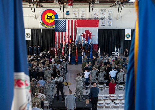 Members of both the North American Aerospace Defense Command and Northern Command as well as international dignitaries from Mexico and Canada attend a change-of-command ceremony held on Peterson Air Force Base, Colo., on May 24, 2018. (Staff Sgt. Emily Kenney/U.S. Defense Department)