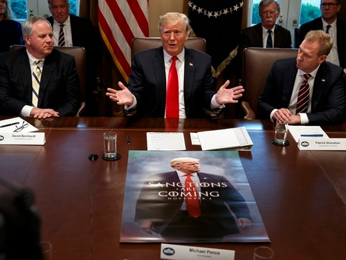Acting Secretary of the Interior David Bernhardt, left, and acting Secretary of Defense Patrick Shanahan, right, listen as President Donald Trump, center, speaks during a Cabinet meeting at the White House on Jan. 2. During the meeting, Trump criticized the performance of former Defense Secretary Jim Mattis and suggested he had fired him from the job. (Evan Vucci/AP)