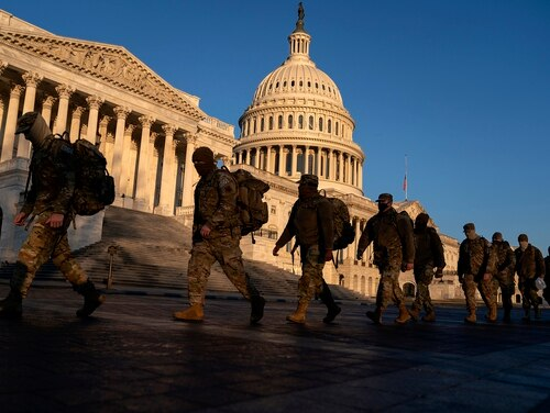 Members of the National Guard gather outside the U.S. Capitol on Jan. 12, 2021, in Washington. (Stefani Reynolds/Getty Images)