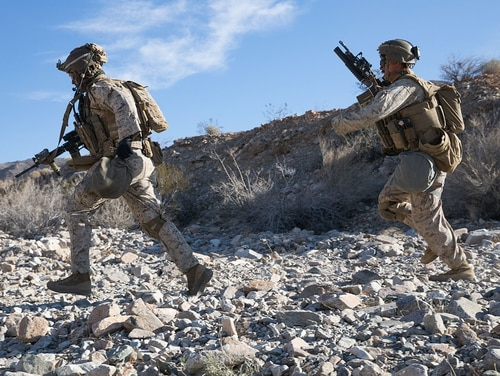 U.S. Marine Corps Sgt. Robert Peas (left) and Lance Cpl. Cameron O'Hara (right), infantry Marines with 2nd Battalion, 5th Marine Regiment, 1st Marine Division, sprint to cover during the Integrated Training Exercise (ITX) at Marine Air Ground Combat Center Twentynine Palms, California, Jan. 25, 2020. (Cpl. Jack C. Howell/ Marine Corps)