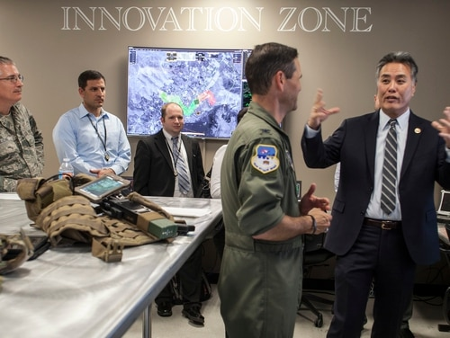 Rep. Mark Takano, D-Calif., right, talks to military officials while touring the Hap Arnold Center at March Air Reserve Base in California on Feb. 23, 2017. Takano will take over as chairman of the House Veterans' Affairs Committee next month. (Airman 1st Class Crystal Housman/Air National Guard)