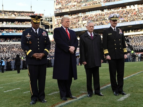 President Donald Trump, second from left, is joined by, from left, West Point Superintendent Lt. Gen. Darryl A. Williams, Defense Secretary Jim Mattis and Naval Academy Superintendent Vice Adm. Ted Carter, for a moment of silence before the start of the Army-Navy college football game in Philadelphia on Dec. 8, 2018. Mattis announced this week he will step down from his leadership role in February. (Susan Walsh/AP)