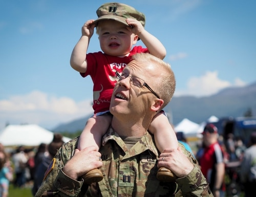 Army Capt. Ben Russell, carries his son Todd, 18-months-old, on his shoulders at the annual Military Appreciation Week picnic at the Joint Base Elmendorf-Richardson, Alaska, June 16, 2017. (U.S. Air Force photo/Justin Connaher)