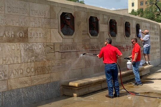 Volunteers work to restore National WWI Museum and Memorial in Kansas City, Missouri after it was vandalized.