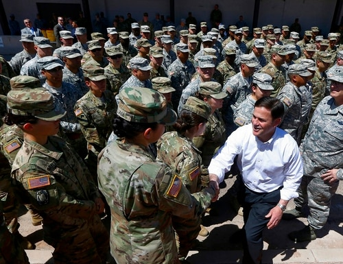 Arizona's Republican Gov. Doug Ducey, front right, meets with Arizona National Guard soldiers prior to their deployment to the Mexico border at the Papago Park Military Reservation on Monday, April 9, 2018, in Phoenix. (Ross D. Franklin/AP)
