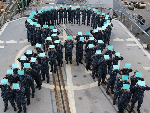 Sailors aboard the cruiser Chancellorsville gather on the flight deck to form a teal ribbon, in recognition of Sexual Assault Prevention Month. (FC2 Monica Strickler/Navy) Join the conversation: http://www.navy.mil/viewGallery.asp http://www.facebook.com/USNavy http://www.twitter.com/USNavy http://navylive.dodlive.mil http://pinterest.com https://plus.google.com
