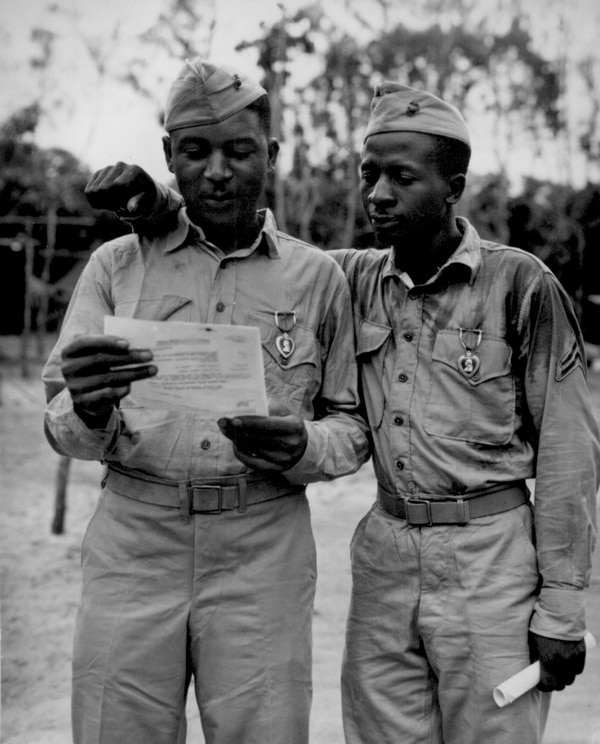 First Negro Marines decorated by the famed Second Marine Division somewhere in the Pacific (left to right) Staff Sgt Timerlate Kirven...and Cpl. Samuel J. Love, Sr... They received Purple Hearts for wounds received in the Battle of Saipan. (National Archives)