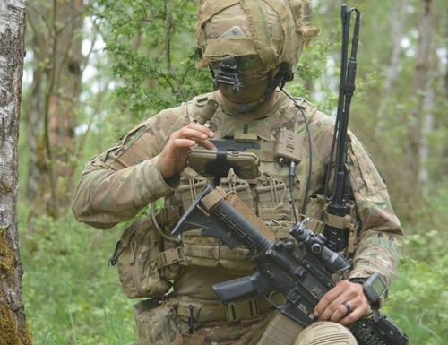 1st. Lt. Michael Austin, platoon leader for Attack Co., 1-503rd Inf. Regt., 173rd Airborne Brigade, uses the Nett Warrior End User Device to report information to his company commander through the Integrated Tactical Network (ITN) during a live-fire exercise in Grafenwoehr, Germany in May, 2018. The exercise helped inform ITN basis of issue and inform ITN design decisions. (U.S. Army photo/Spc. Joshua Cofield)