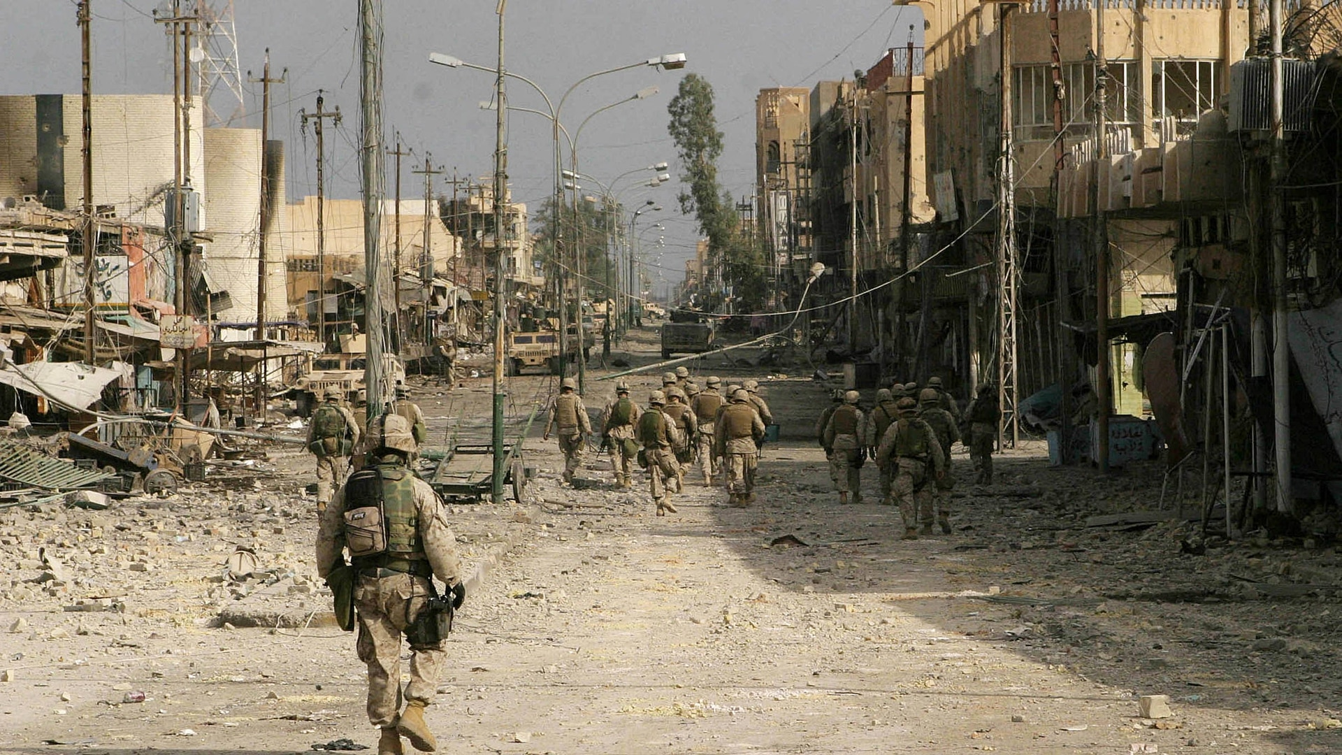 This picture released Nov. 23, 2004, by the Multi National Force-Iraq shows Marines patrolling with members of the Iraqi Special Operations Forces in the devastated city of Fallujah, Iraq. (MNF-I/AFP via Getty Images)