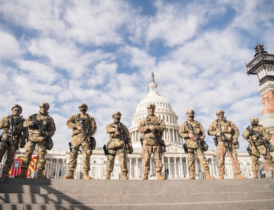 Virginia National Guard airmen assigned to the 192nd Security Forces Squadron, 192nd Mission Support Group, 192nd Wing help to secure the grounds near the U.S. Capitol, Jan. 13, 2021, in Washington. (Staff Sgt. Bryan Myhr/Air National Guard)