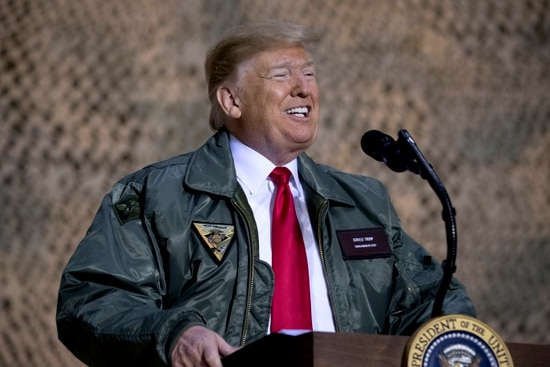 In Iraq visit, Trump makes false claims about military pay again