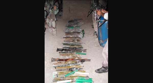 Cache of weapons confiscated in Fallujah by Staff Sgt. David Bellavia and his unit. (Army)