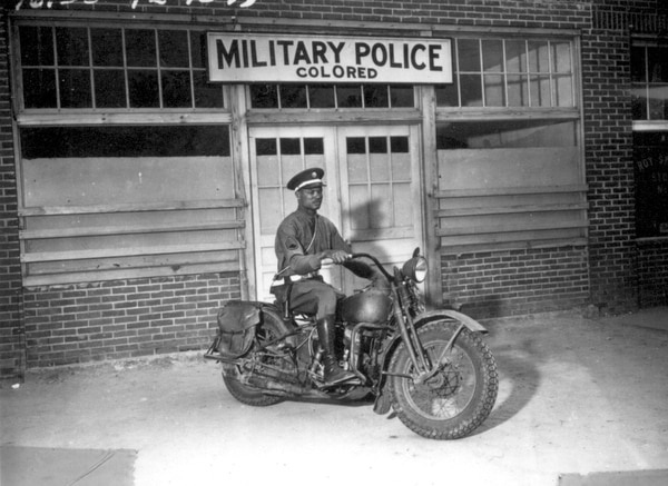An MP on motorcycle stands ready to answer all calls around his area, Columbus, Georgia, April 13, 1942. (Pfc. Victor Tampone, now in the collections of the National Archives)