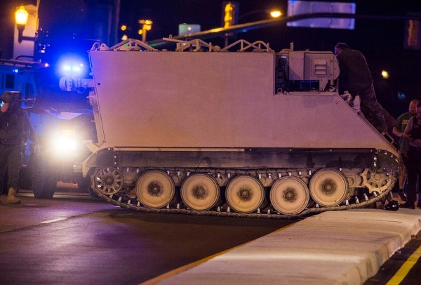 Emergency personnel surround a National Guard military vehicle stolen from Fort Pickett, Va., on June 5, 2018. Police said they arrested a soldier who stole the armored personnel carrier after chasing him for more than 60 miles. (Grace Hollars/Richmond Times-Dispatch via AP)