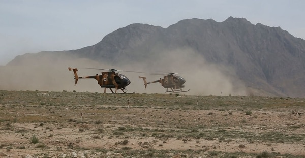 Afghan MD-530s land during a close air attack training scenario with Afghan tactical air coordinators. (Defense Department)