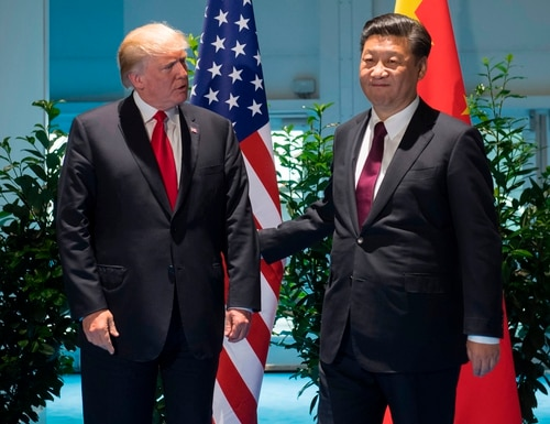 U.S. President Donald Trump and Chinese President Xi Jinping, right, arrive prior to a meeting on the sidelines of the G20 Summit in Hamburg, Germany, on July 8, 2017. (Saul Loeb/AFP via Getty Images)