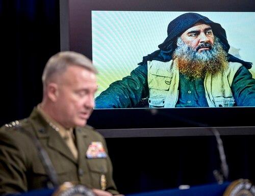 Abu Bakr al-Baghdadi is displayed on a monitor as U.S. Central Command Commander Marine Gen. Kenneth McKenzie at a joint press briefing at the Pentagon in Washington, Wednesday, Oct. 30, 2019, on the Abu Bakr al-Baghdadi raid. (Andrew Harnik/AP)