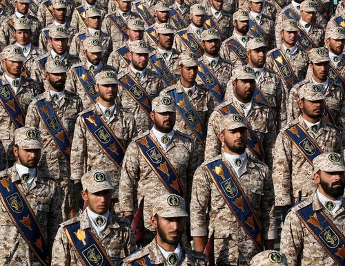 Revolutionary Guard troops attend a military parade marking 39th anniversary of outset of Iran-Iraq war, in front of the shrine of the late revolutionary founder Ayatollah Khomeini, just outside Tehran, Iran, Sunday, Sept. 22, 2019. (Iranian Presidency Office via AP)