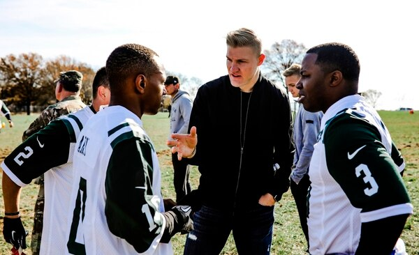 New York Jets quarterback Josh McCown, center, huddles up with his squad of military members at Fort Hamilton Army Base during a game of flag football in Brooklyn borough of New York, Tuesday, Nov. 21, 2017. (New York Jets.com/New York Jets via AP)
