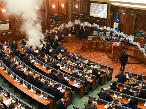 Kosovo's opposition lawmakers release a teargas canister inside the country's parliament in Pristina on March 21, 2018, before a vote for an agreement to ratify or not a border demarcation deal signed in 2015 with Montenegro. (Armend Nimani/AFP/Getty Images)