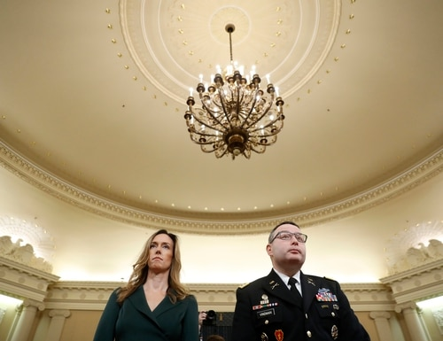 Jennifer Williams, an aide to Vice President Mike Pence, and National Security Council aide Lt. Col. Alexander Vindman stand as they take a break in hearing before the House Intelligence Committee on Capitol Hill in Washington, Tuesday, Nov. 19, 2019. (Andrew Harnik/AP)