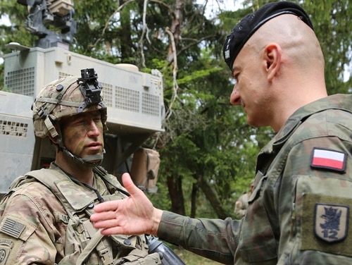 Polish Maj. Gen. Rajmund Andrezejczak, right, works through a plan with U.S. Army Col. David Gardner at the Joint Warfighting Assessment in Hohenfels, Germany, on May 3, 2018. (Staff Sgt. Kalie Frantz/U.S. Army)