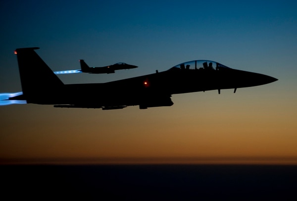 A pair of Air Force F-15E Strike Eagles fly over northern Iraq after conducting airstrikes in Syria. A new advisory team stood up Feb. 1 aims to prepare the Iraqi air force to take on more air missions and responsibilities. (Senior Airman Matthew Bruch/Air Force)