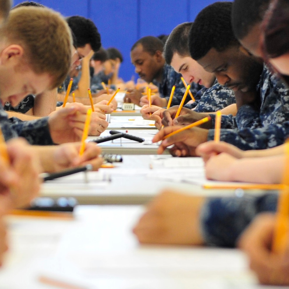 Exams for 20 auto-advance ratings are being nixed (MC2 Cory Rose/Navy).