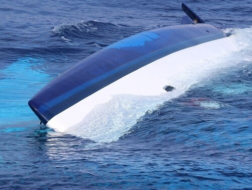 The 37-foot catamaran, Surf into Summer, was found partially submerged on May 15, 2017 in the Florida Straits, about 30 miles west of Cay Sal, Bahamas. (Coast Guard)