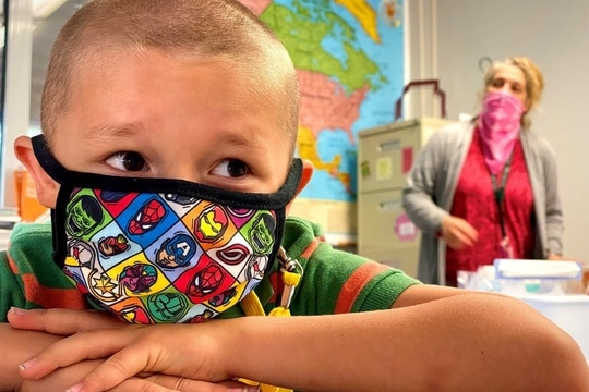 Sporting an Avengers coronavirus mask, Liam Hall waits for his second grade class to begin at Patch Elementary School, at Panzer Kaserne in Böblingen, Germany. (Rick Scavetta, U.S. Army Garrison Stuttgart)