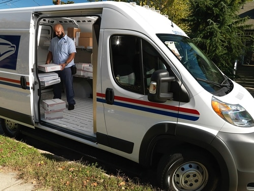 The U.S. Postal Service projects that it will need to dramatically increase spending to meet needed updates like replacing the outdated delivery vehicle fleet. (USPS)