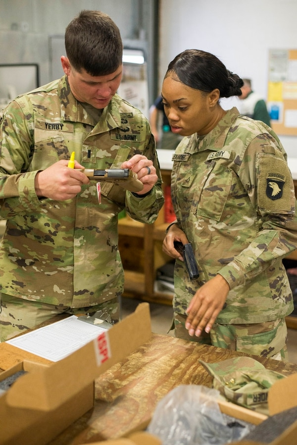 First Lt. Jon Yerby and Pvt. 1st Class Tia Alexander, of 1st Brigade Combat Team, 101st Airborne Division, inspect and inventory an M17 Nov. 27. (Sgt. Samantha Stoffregen/Army)