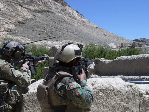 An Afghan commando from 8th Special Operations Kandak and a U.S. Special Forces soldier scan the horizon for enemy movement during an operation in Wardak province, Afghanistan, on May 24, 2018. The incoming head of U.S. Central Command on Tuesday said he has no idea when U.S. forces may finish their military mission in the country. (Sgt. Paul Sale/Army)