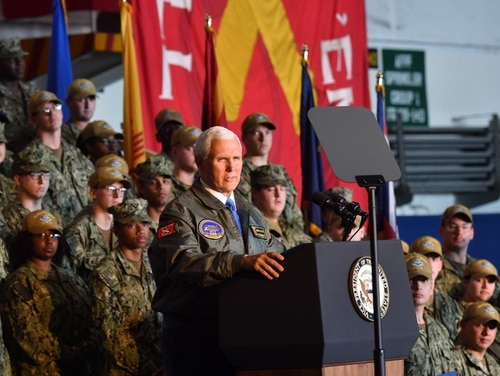 Vice President Mike Pence speaks to sailors in the hangar bay of the aircraft carrier Harry S. Truman. (Mass Communication Specialist 3rd Class Adelola Tinubu/Navy)