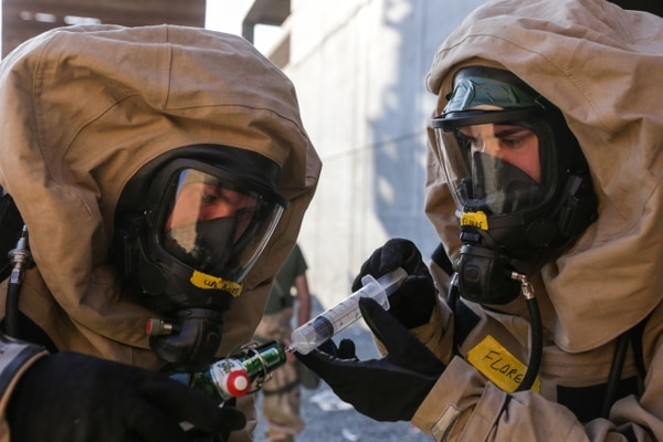 Chemical, Biological, Radiological, and Nuclear Marines with the 11th Marine Expeditionary Unit test for possible contamination during a CBRN response training scenario as part of MEU Exercise May 9, 2016 at Marine Corps Base Camp Pendleton, Calif. MEUEX is designed to test the 11th MEU's ability to plan, brief and execute missions, while commanding and controlling forces from a shore-based expeditionary site. This enhances the MEU's warfighting capability in preparation for its upcoming Western Pacific 16-2 deployment. (U.S. Marine Corps photo by Lance Cpl. Devan Gowans/Released)