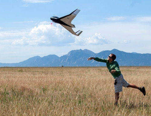CU-Boulder aerospace engineering graduate student Anthony Carfang launches a UAV for testing north of Boulder. (Photo by Glenn Asakawa/University of Colorado)