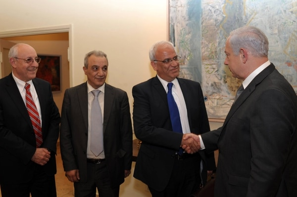 JERUSALEM, ISRAEL - APRIL 17: In this handout image provided by the Israeli Government Press Office (GPO), Israel's Prime Minister Benjamin Netanyahu shakes hands with Palestinian chief negotiator Saeb Erekat watched by Netanyahu's personal envoy, attorney Yitzhak Molcho and the head of Palestinian Authority General Intelligence Majad Faraj during their meeting on April 17, 2012 in Jerusalem, Israel. At the end of the meeting, it was agreed to release the following statement:
