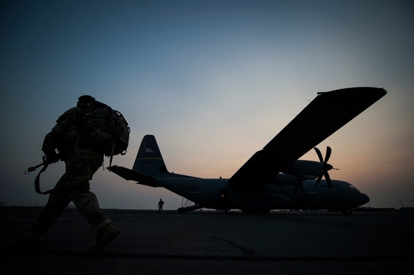 A soldier approaches a C-130J Super Hercules assigned to the 41st Airlift Squadron, Little Rock Air Force Base, Arkansas, at Grant County International Airport, near Moses Lake, Washington, during Mobility Guardian on Thursday. (Tech. Sgt. Larry E. Reid Jr./Air Force)