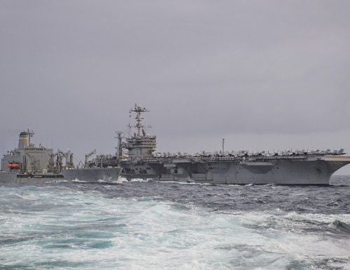 The carrier Harry S. Truman conducts a replenishment-at-sea with the fleet replenishment oiler Big Horn while operating in the Norwegian Sea. (MC2 Cameron Stoner/Navy)