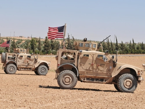 U.S. personnel use tactical vehicles to provide security during a patrol outside Manbij, Syria, on Aug. 11, 2018. These independent, coordinated patrols are conducted with Turkish military forces who stay on the opposite side of the demarcation line. (Sgt. Nicole Paese/Army)
