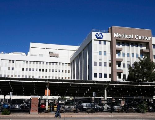 FILE - This Monday, April 28, 2014 file photo shows the Phoenix VA Health Care Center. (AP Photo/Ross D. Franklin)