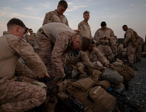 U.S. Marines assigned to Special Purpose Marine Air-Ground Task Force-Crisis Response-Central Command (SPMAFTF-CR-CC) 19.2, prepare to deploy from Kuwait in support of a crisis response mission, Dec. 31, 2019. (Sgt. Robert Gavaldon/Marine Corps)