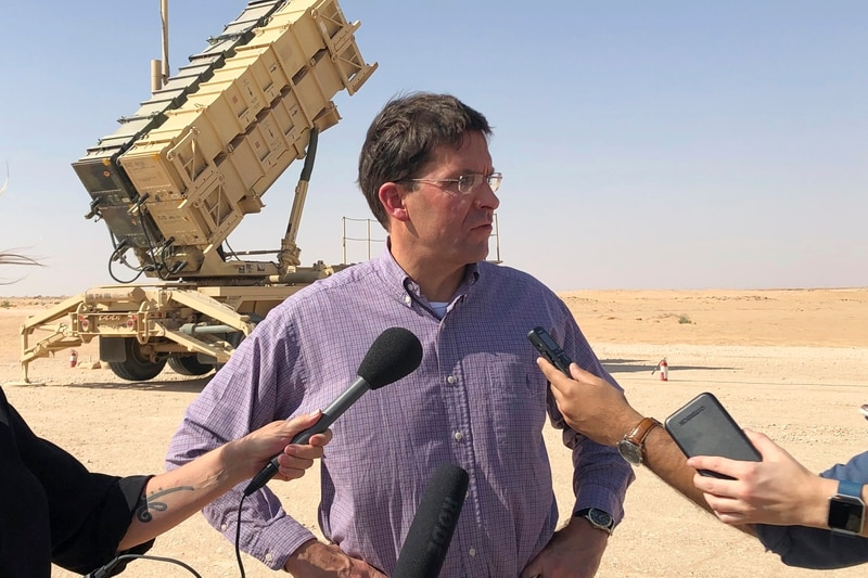 Defense Secretary Mark Esper talks to reporters at Prince Sultan Air Base in Saudi Arabia, Tuesday, Oct. 22, 2019, where he saw a Patriot missile battery that the U.S. sent to Saudi to help protect the kingdom against the Iranian threat. (Lolita Baldor/AP)