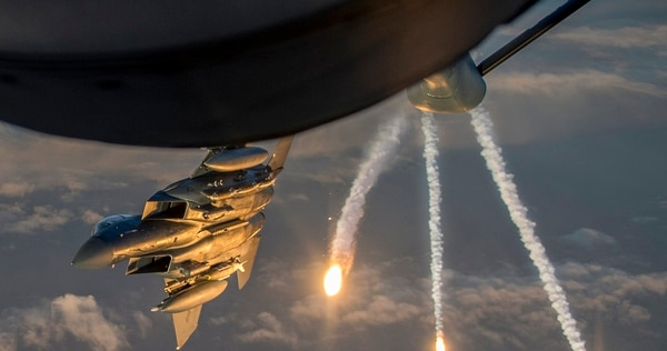 A U.S. Air Force F-15 Eagle deploys flares while departing from a KC-135 Stratotanker. Both aircraft will be participating in a multi-national exercise in Ukraine next month. (Tech. Sgt. Paul Labbe/Air Force)
