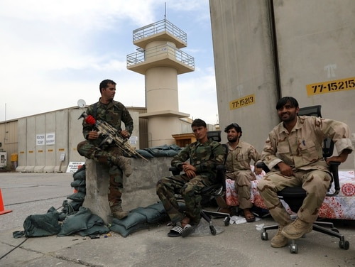 Afghan security forces keep watch after the American military left Bagram air base, in Parwan province north of Kabul, Afghanistan, Monday, July 5, 2021. (Rahmat Gul/AP)