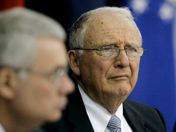 In this April 11, 2007, file photo, John O. ''Jack'' Marsh, Army secretary during the Reagan administration and co-chairman of the independent review group, meets with officials at Walter Reed Army Medical Center to discuss their findings, in Washington. Marsh, who also served four terms as Virginia's 7th District congressman, died at age 92 on Feb. 4. (Haraz N. Ghanbari/AP)