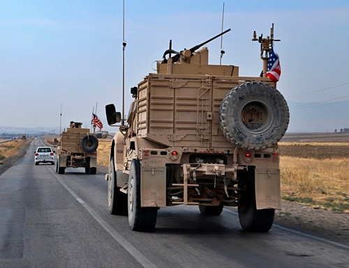 A U.S. military convoy arrives near Dahuk, Iraqi, Monday, Oct. 21, 2019. (AP Photo)
