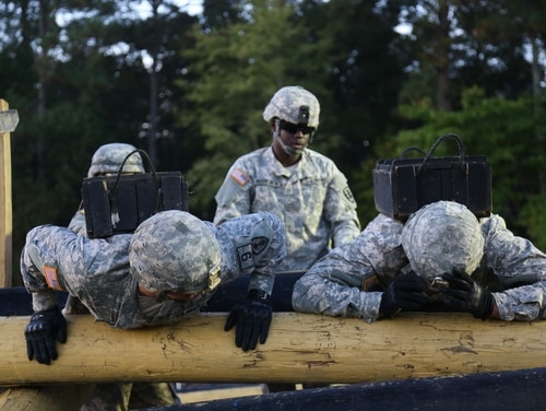U.S. Army Staff Sgt. Luke Klein (left), assigned to the U.S Army South, navigates the obstacle course at the Best Warrior Competition at Fort Lee, Va., Oct. 9, 2014. Best Warrior Competition events are designed to measure the Soldiers' physical abilities, leadership skills, teamwork and critical thinking. (U.S. Army photo by Jordan Talbot / Released)