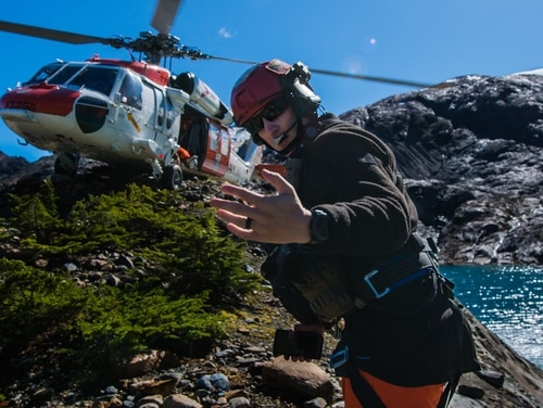Chief Hospital Corpsman Wayne Papalski, assigned to Naval Air Station Whidbey Island Search and Rescue gives the signal to sailors to safely enter a MH-60S Sea Hawk during a high altitude training in the North Cascades. The NAS Whidbey Island SAR team put its training into practice late Tuesday night when it rescued two climbers stuck on the 8,800-foot Forbidden Peak. (MC2 Ignacio D. Perez/Navy)