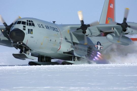 Members of the New York Air National Guard's 109th Airlift Wing use jets to assist in the takeoff of their ski-equipped LC-130